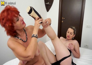 hot girl and a redhead aged mamma having great