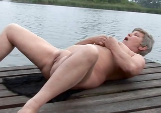 granny is masturbating outdoors